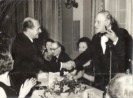 Mather receiving his Crime Writers' Award from Sir Compton Mackenzie in 1962. Also pictured is the critic and novelist Julian Symons.